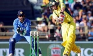 Australia's Steve Smith (R) hits a six as India's wicketkeeper MS Dhoni looks on during the One Day International cricket match in Perth January 12, 2016. REUTERS/Bill Hatto