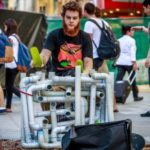 Street Performer Plays House/Techno/Pop Set Using PVC Pipes And Flip Flops